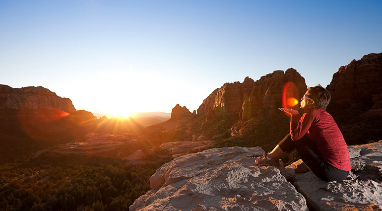 Woman watching sunrise in Arizona